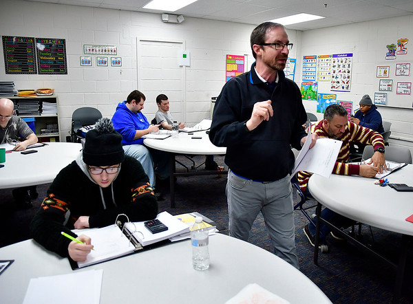 2/12/2020 Mike Orazzi | Staff Bristol Adult Education Instructor Brian Reardon teaches a class on manufacturing math on Wednesday afternoon.