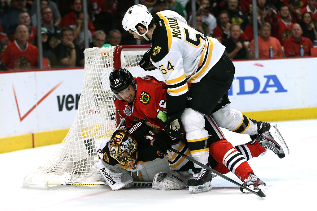 . CHICAGO, IL - JUNE 22:  Marcus Kruger #16 of the Chicago Blackhawks trips over Tuukka Rask #40 of the Boston Bruins in the net during Game Five of the 2013 NHL Stanley Cup Final at United Center on June 22, 2013 in Chicago, Illinois.  (Photo by Bruce Bennett/Getty Images)