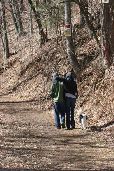 Catherine, Drew and Bessie hiking Spivey Mountain