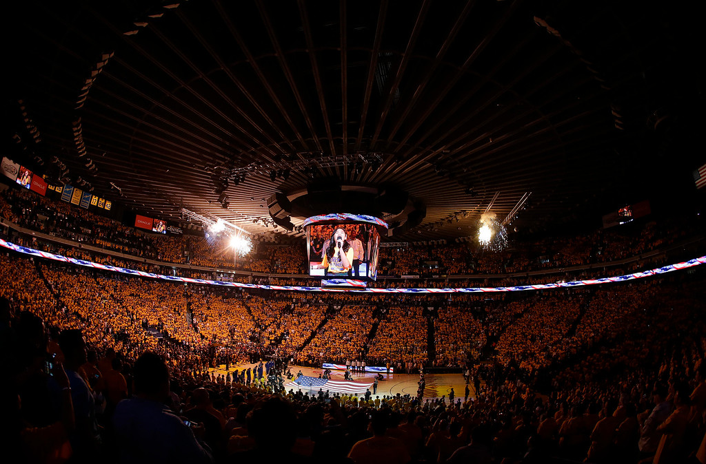 . Fans at Oracle Arena watch as Nayah Damasen performs the national anthem before Game 1 of basketball\'s NBA Finals between the Golden State Warriors and the Cleveland Cavaliers in Oakland, Calif., Thursday, June 4, 2015. (AP Photo/Eric Risberg)