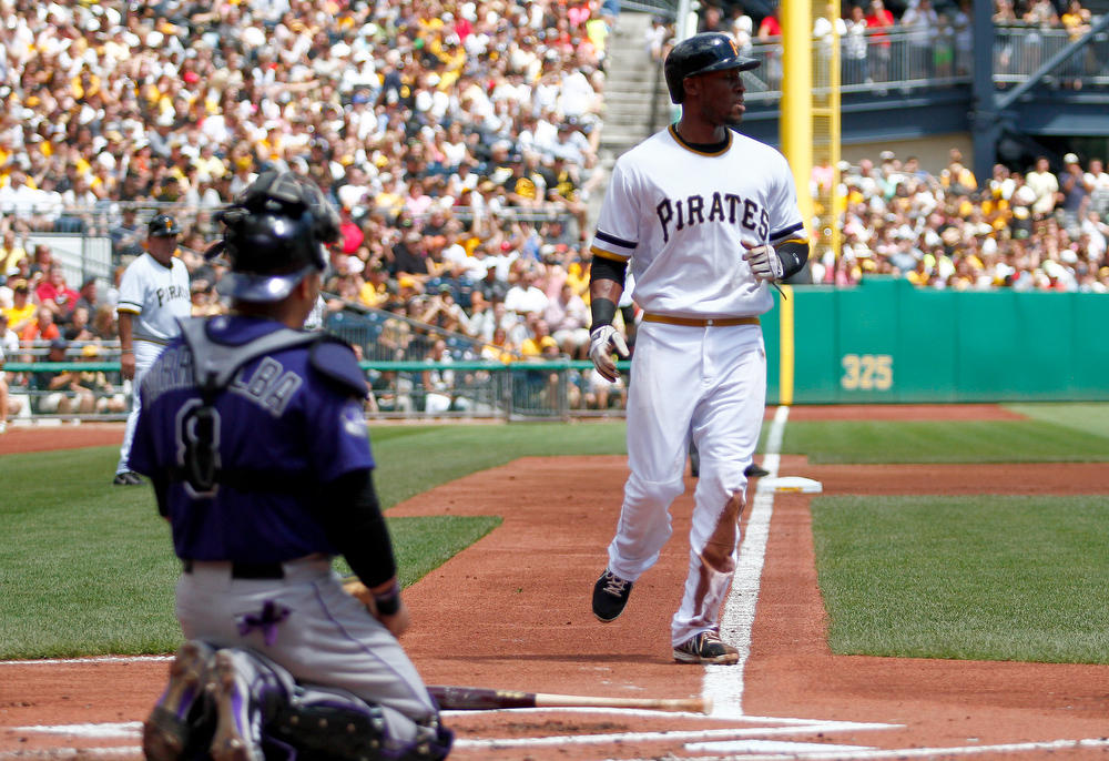 . Starling Marte #6 of the Pittsburgh Pirates scors on an RBI single in the first inning against the Colorado Rockies during the game on August 4, 2013 at PNC Park in Pittsburgh, Pennsylvania.  (Photo by Justin K. Aller/Getty Images)
