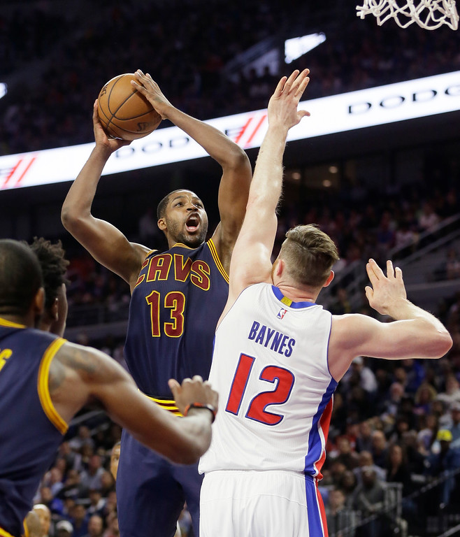 . Cleveland Cavaliers center Tristan Thompson (13) shoots over Detroit Pistons center Aron Baynes (12) during the first half in Game 4 of a first-round NBA basketball playoff series, Sunday, April 24, 2016 in Auburn Hills, Mich. (AP Photo/Carlos Osorio)