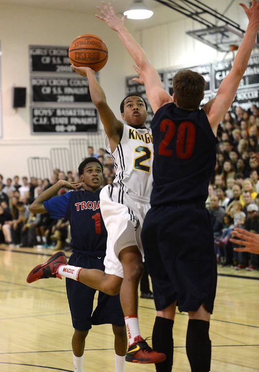 . Bishop Montgomery\'s Justin Bibbins (21) tries to shoot around  La Verne Lutheran\'s McKay Anderson (20) in a CIF SS Division IV-AA semifinal game in Torrance Friday night. Lutheran stunned Bishop Montgomery 63-59, ending their unbeaten season. 20130222 Photo by Steve McCrank / Staff Photographer