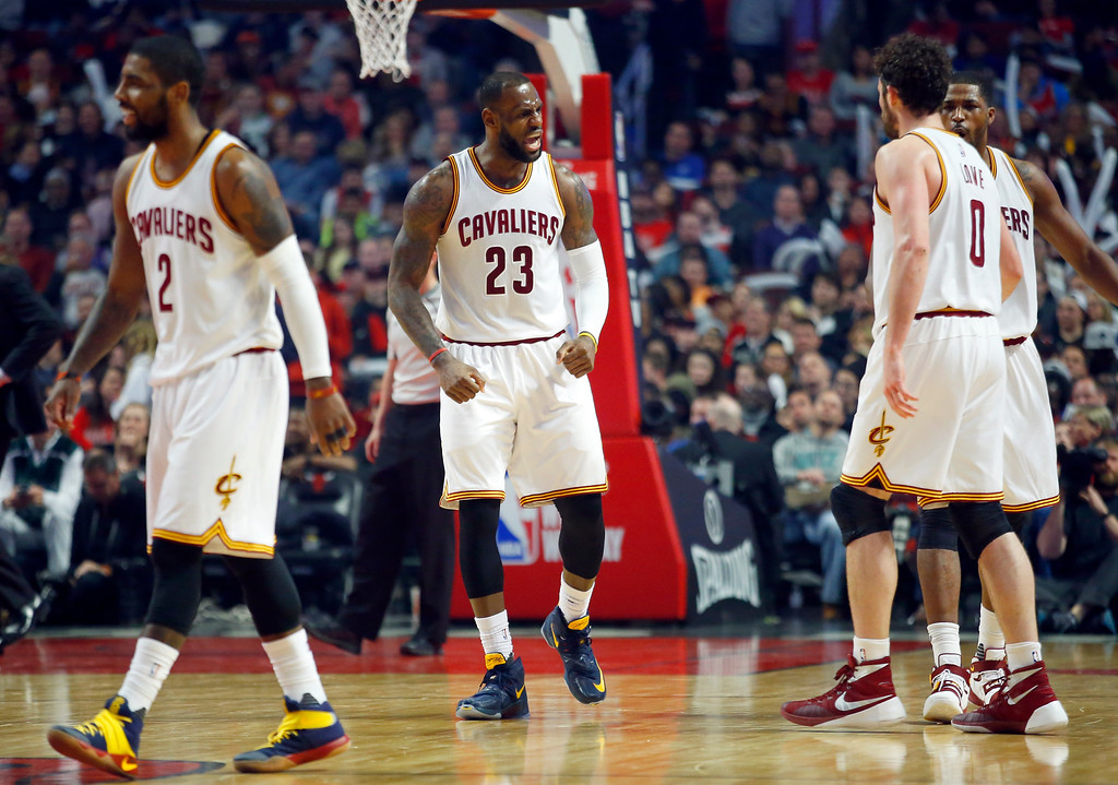. Cleveland Cavaliers forward LeBron James (23) yells to teammates after a basket by forward Kevin Love (0) against the Chicago Bulls during the second half of an NBA basketball game in Chicago, on Saturday, April 9, 2016.  (AP Photo/Jeff Haynes)