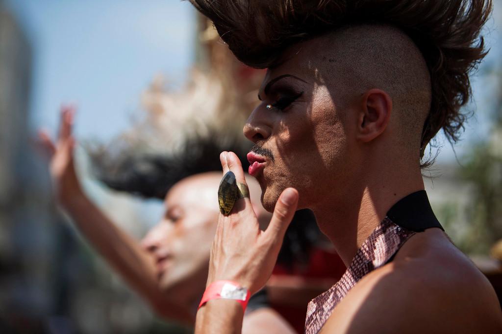 . A dancer gestures to the crowd as he takes part in the annual Gay Pride parade in Tel Aviv June 7, 2013.  REUTERS/Nir Elias