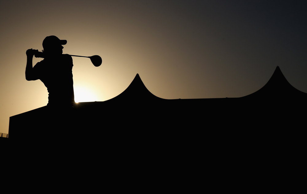 . Rory McIlroy of Northern Ireland hits his tee-shot on the first hole during the first round of The Abu Dhabi HSBC Golf Championship at Abu Dhabi Golf Club on January 17, 2013 in Abu Dhabi, United Arab Emirates.  (Photo by Andrew Redington/Getty Images)