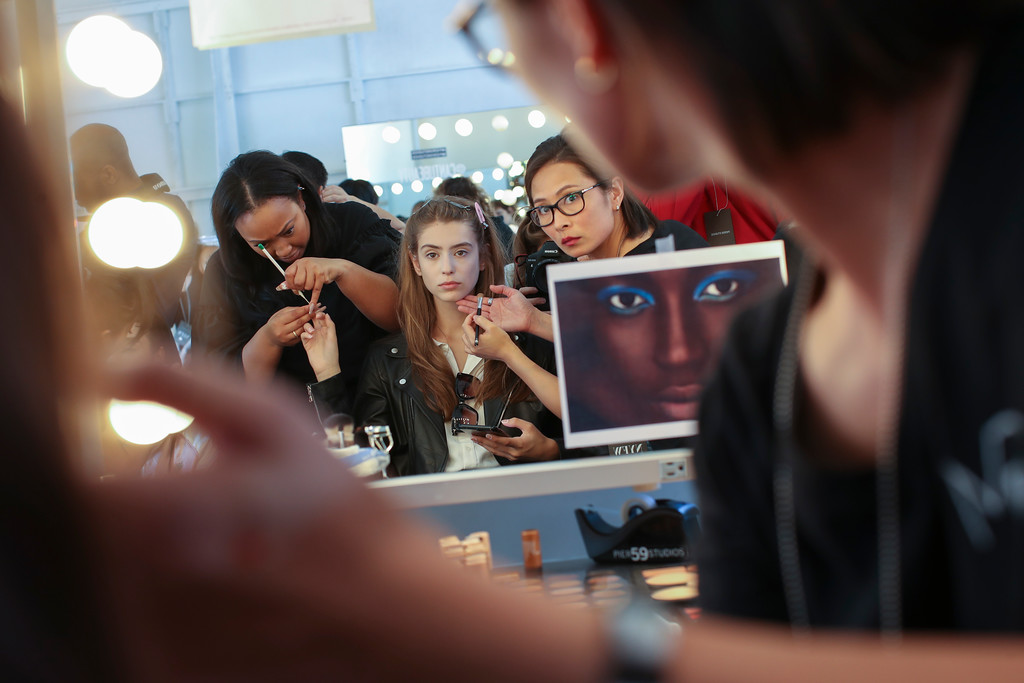 . A model has her make up done backstage ahead of the Tracy Reese Spring 2018 presentation during New York Fashion Week, Sunday, Sept. 10, 2017. (AP Photo/Mary Altaffer)