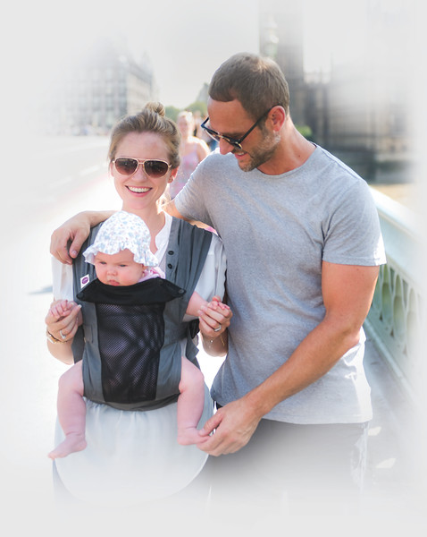Izmi_Baby_Carrier_Breeze_Mid_Grey_Lifestyle_Front_Facing_Carry_Mum_And_Dad_Walking_In_City_Big_Ben_Faded.jpg