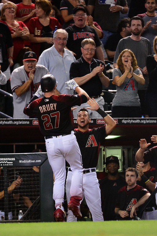 . Brandon Drury #27 of the Arizona Diamondbacks is congratulate by teammate David Peralta #6 after hitting a two run home run against the Colorado Rockies during the sixth inning at Chase Field on April 30, 2016 in Phoenix, Arizona.  (Photo by Jennifer Stewart/Getty Images)