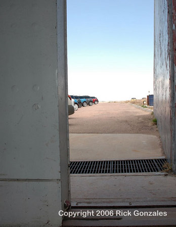 Inside the missile bay, looking out the partially opened vertical, sliding door, which was over one foot thick. It is now motorized, but was manually opened by Air Force personnel using a crank with reduction gears (nine crank rotations per one foot of door travel).