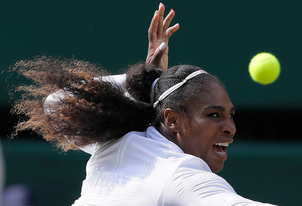 . Serena Williams of the United States returns the ball to Germany\'s Julia Gorges during their women\'s singles semifinals match at the Wimbledon Tennis Championships, in London, Thursday July 12, 2018.(AP Photo/Kirsty Wigglesworth)