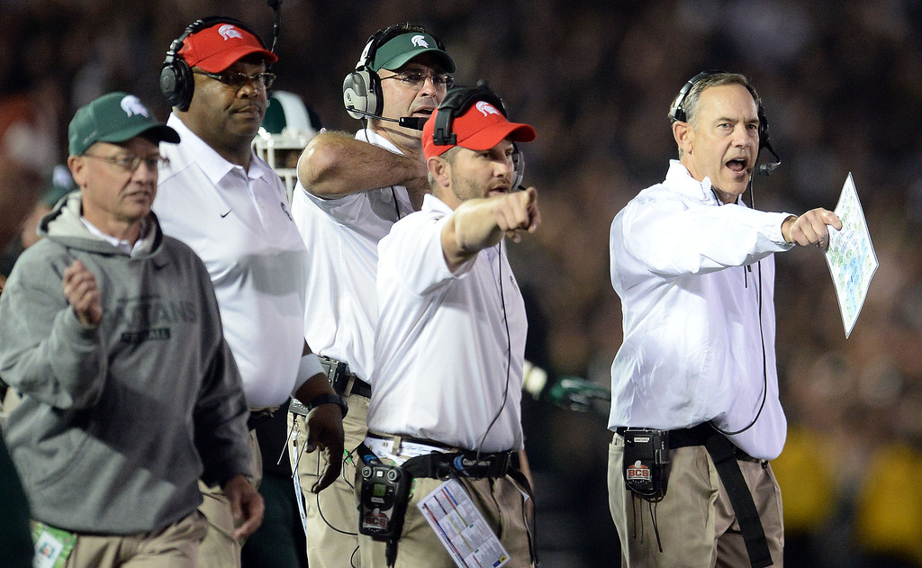. Michigan State head coach Mark Dantonio, right, reacts after a penalty on Stanford in the second half of the 100th Rose bowl game in Pasadena, Calif., on Wednesday, Jan.1, 2014. Michigan State won 24-20.