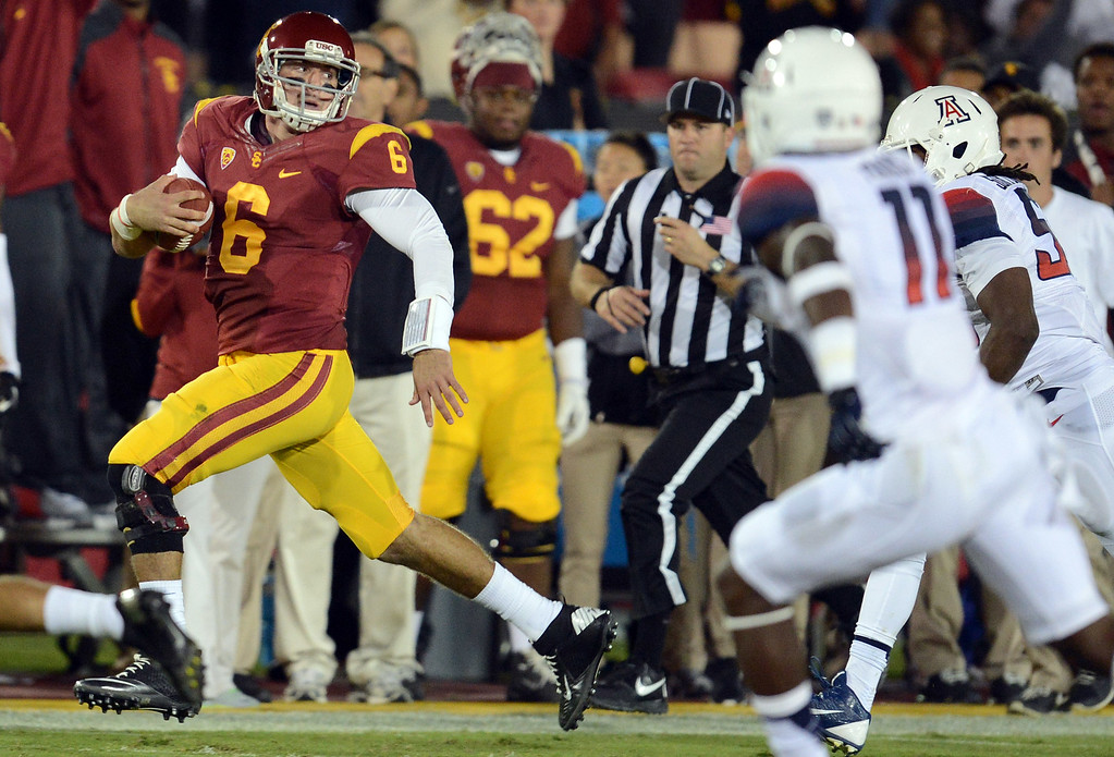 . USC\'s  Cody Kessler #6 scrambles for some yards during their game against Arizona at the Los Angeles Memorial Coliseum Thursday, October 10, 2013. USC defeated Arizona 38-31. (Photo by Hans Gutknecht/Los Angeles Daily News)