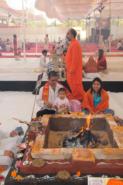 Swami Swaroopanandaji visiting everyone at the 108 havan kunds at Chinmaya Mission Mumbai's Maha Jnana Yajna and 108 Samashti Havan. Seen is the Khemlani family (Kailash).Chant Mumbai. Shaant Mumbai.Thousands of Mumbaikars came together on Sunday, 15th Feb 2009 to jointly chant 'Hanuman Chalisa', at a congregation called 'Chant Mumbai Shaant Mumbai'. The congregation was organised by Chinmaya Mission at Andheri Sports Complex for the peace and prosperity for the city of Mumbai.