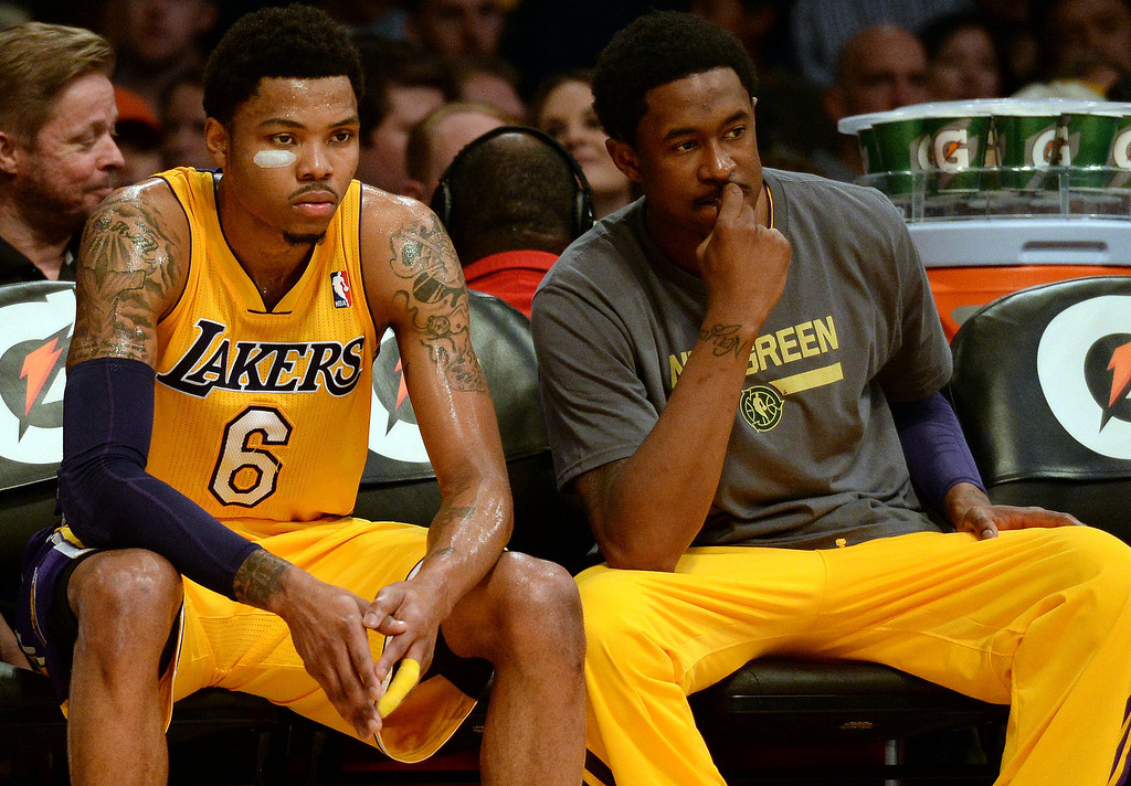. Los Angeles Lakers\' Kent Bazemore (6) sits on the bench in the second half during an NBA basketball game against the Dallas Mavericks in Los Angeles, Calif., on Friday, April 4, 2014. Dallas Mavericks won 107-95.  (Keith Birmingham Pasadena Star-News)