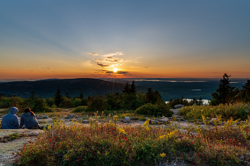 """""""The best and most beautiful things in the world cannot be seen nor touched..but are felt in the heart."""" - Helen Keller<br /> <br /> A young couple enjoys the glorious sunset atop Cadillac Mountain on a cool, early evening. - Cadillac Mountain Summit, Acadia National Park"""