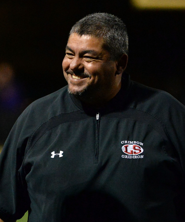 . La Serna head coach Margarito Beltran is all smiles after a touchdown by Bryce Oliver (not pictured) in the first half of a CIF-SS playoff football game against Diamond Bar at Diamond Bar High School in Diamond Bar, Calif., on Friday, Nov. 22, 2013.   (Keith Birmingham Pasadena Star-News)