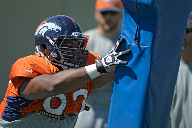 . Denver Broncos NT Sylvester Williams (92) hits the sled during training camp August 12, 2013 at Dove Valley. (Photo By John Leyba/The Denver Post)