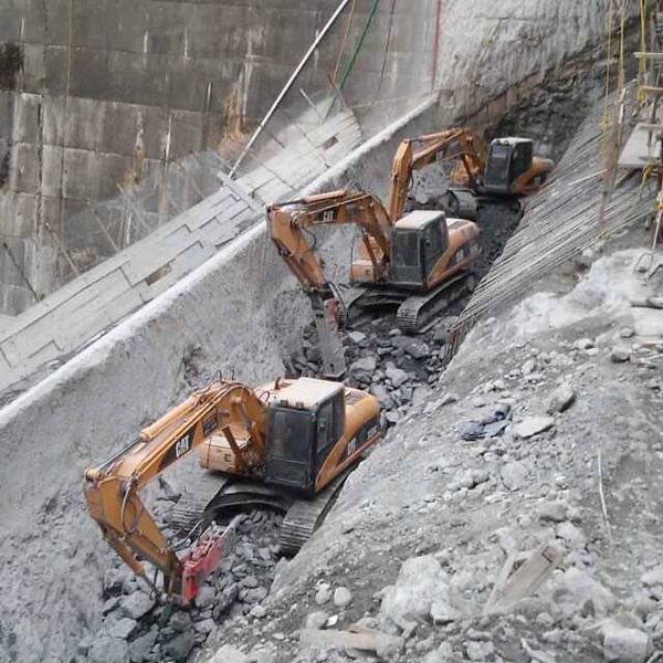 NPK GH9 hydraulic hammers on Cat excavators - primary demolition - dam expansion (2).jpg