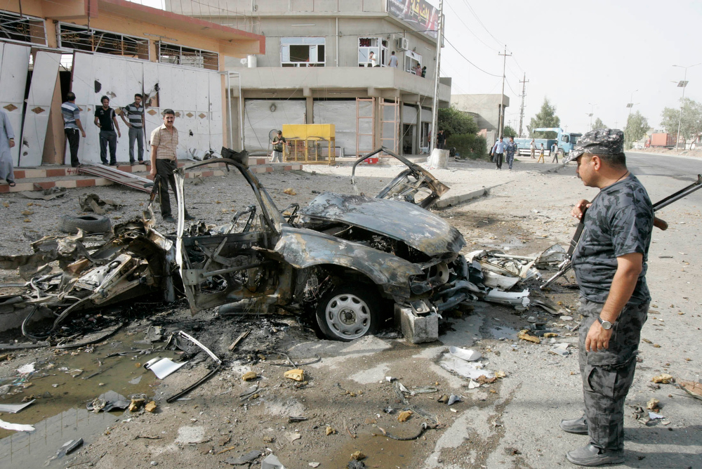Description of . Security personnel inspect the site of a car bomb attack in Kirkuk, 250 km (155 miles) north of Baghdad, August 16, 2012. Two car bombs went off simultaneously in Iraq's ethnically mixed oil-rich city of Kirkuk on Thursday, killing three people and wounding 10 others, police and hospital sources said.  REUTERS/Ako Rasheed