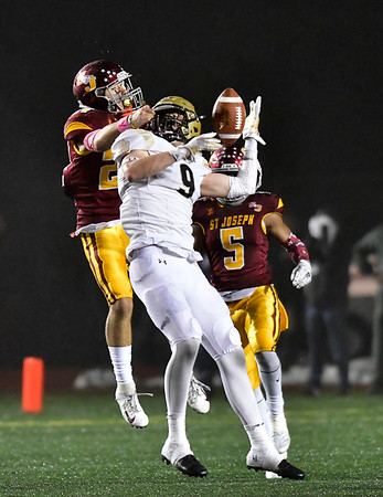 12/14/2019 Mike Orazzi | StaffrSt. Joseph High School's Preston Kral (24) and Daniel Hand's Ethan Haberman (9) during a 17-13 Cadets win at Veteran's Stadium in New Britain on Saturday. r?r.r