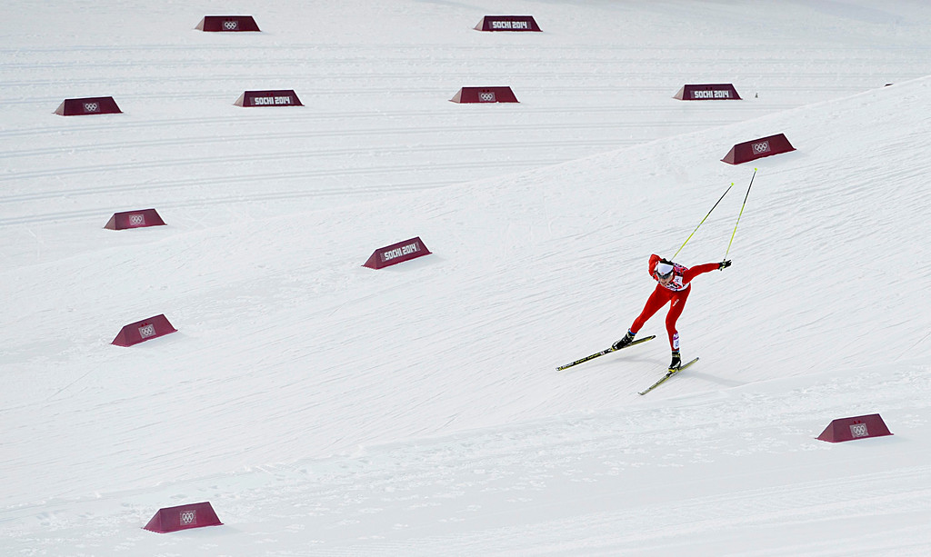 . Dario Cologna of Switzerland in action during the men\'s 15km + 15km Skiathlon competition in the Laura Cross Country Center at the Sochi 2014 Olympic Games, Krasnaya Polyana, Russia, 09 February 2014.  EPA/FILIP SINGER