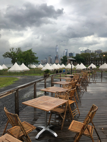 The rain-washed dining area at Collective Governor's Island