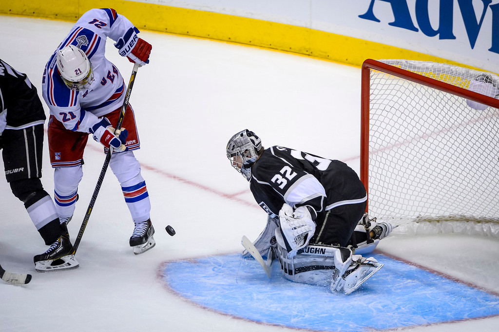 . Kings Jonathan Quick blocks this shot by Rangers Derek Stepan during third period action at Game 1 of the Stanley cup Finals at Staples Center Wednesday, June 4, 2014 ( Photo by David Crane/Los Angeles Daily News )