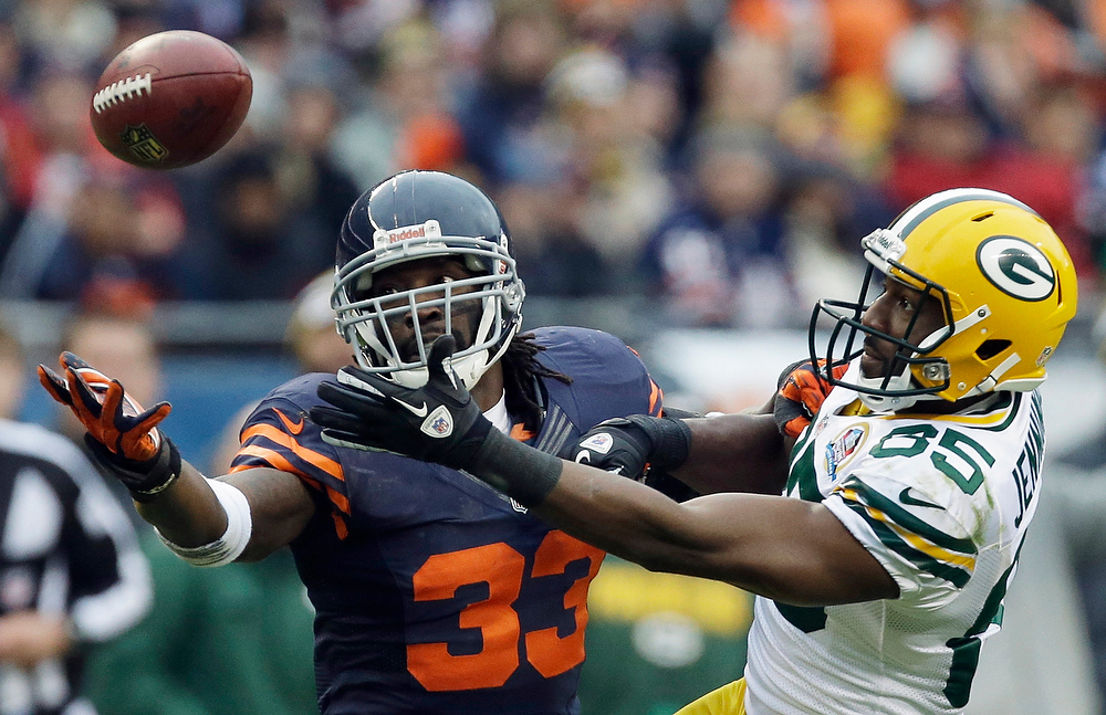 . Chicago Bears cornerback Charles Tillman (33) breaks up a pass intended for Green Bay Packers wide receiver Greg Jennings (85) in the second half of an NFL football game in Chicago, Sunday, Dec. 16, 2012. The Packers won 21-13 to clinch the NFC North division title. (AP Photo/Nam Y. Huh)