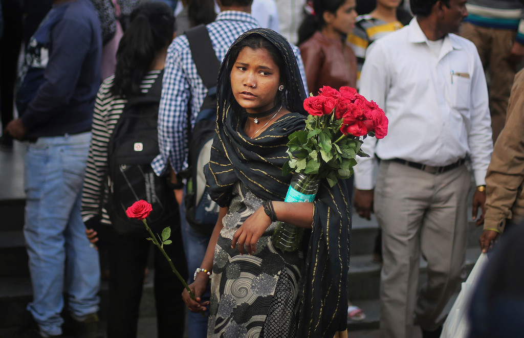. An Indian street vendor sells roses outside a metro station on Valentine\'s Day in New Delhi, India, Tuesday, Feb. 14, 2017. (AP Photo/Altaf Qadri)