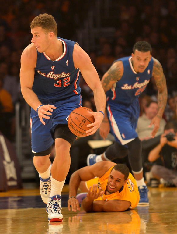 . Clippers#32 Blake Griffin steals the ball from Lakers#7 Xavier Henry in the first half. The Los Angeles Lakers played the Los Angeles Clippers in the opening game of the season at Staples Center. Los Angeles, CA. 10/29/2013. photo by (John McCoy/Los Angeles Daily News)