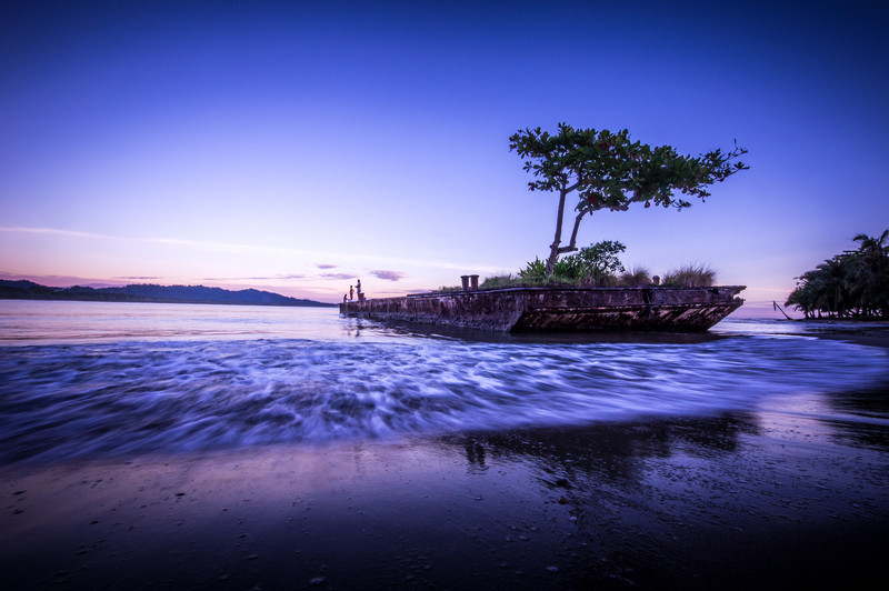 Beached barge in Puerto Viejo, Costa Rica.  Was lucky to have kids and their father fishing off the back during sunrise.