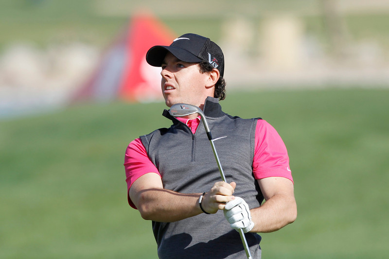. Rory McIlroy of Northern Ireland watches his shot at the first hole during the first round of the Abu Dhabi Golf Championship at the Abu Dhabi Golf Club January 17, 2013. REUTERS/Ahmed Jadallah