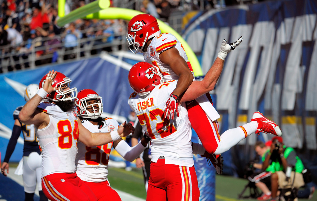 . Kansas City Chiefs running back Knile Davis, above, celebrates with teammates after scoring a touchdown against the San Diego Chargers during the first half in an NFL football game, Sunday, Dec. 29, 2013, in San Diego. (AP Photo/Denis Poroy)
