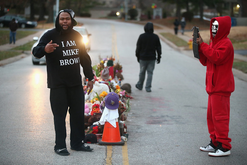. Residents begin to gather at the Michael Brown memorial ahead of the grand jury announcement on November 24, 2014 in Ferguson, Missouri. Ferguson has been struggling to return to normal after Brown, an 18-year-old black man, was killed by Darren Wilson, a white Ferguson police officer, on August 9. His death has sparked months of sometimes violent protests in Ferguson. A grand jury is expected announce today if Wilson should be charged in the shooting.  (Photo by Scott Olson/Getty Images)