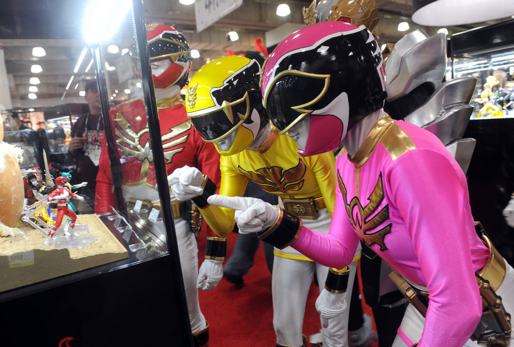 . The Power Rangers check out their 20th anniversary collectibles at the American International Toy Fair, Sunday, Feb. 10, 2013, in New York. Saban Brands is celebrating the 20th anniversary of the Power Rangers franchise at the show. (Diane Bondareff/Invision for Saban Brands/AP Images)