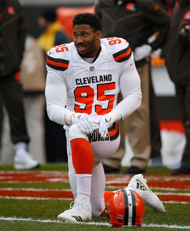 . Cleveland Browns defensive end Myles Garrett stretches before an NFL football game between the Baltimore Ravens and the Cleveland Browns, Sunday, Dec. 17, 2017, in Cleveland. (AP Photo/Ron Schwane)
