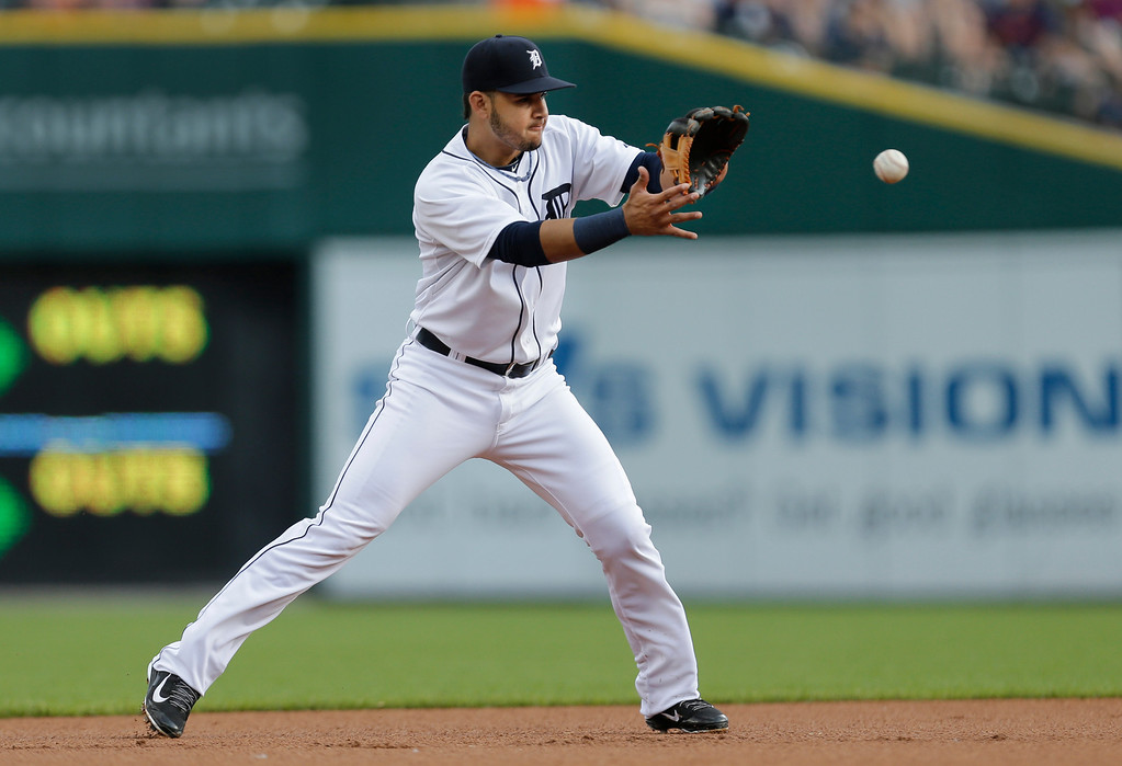 . Detroit Tigers shortstop Eugenio Suarez fields a Kansas City Royals ground ball in the first inning of a baseball game in Detroit, Monday, June 16, 2014.  (AP Photo/Paul Sancya)