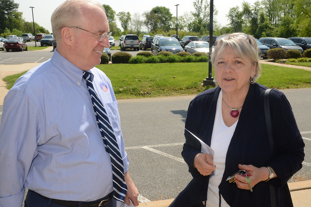 . PETE  BANNAN-DIGITAL FIRST MEDIA          Republican candidate for Congress, Greg McCauley, speaks with Jackie Blake outside their Chadds Ford polling place at Hillendale Elementary school.