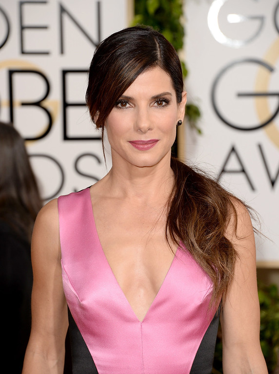 . Actress Sandra Bullock attends the 71st Annual Golden Globe Awards held at The Beverly Hilton Hotel on January 12, 2014 in Beverly Hills, California.  (Photo by Jason Merritt/Getty Images)