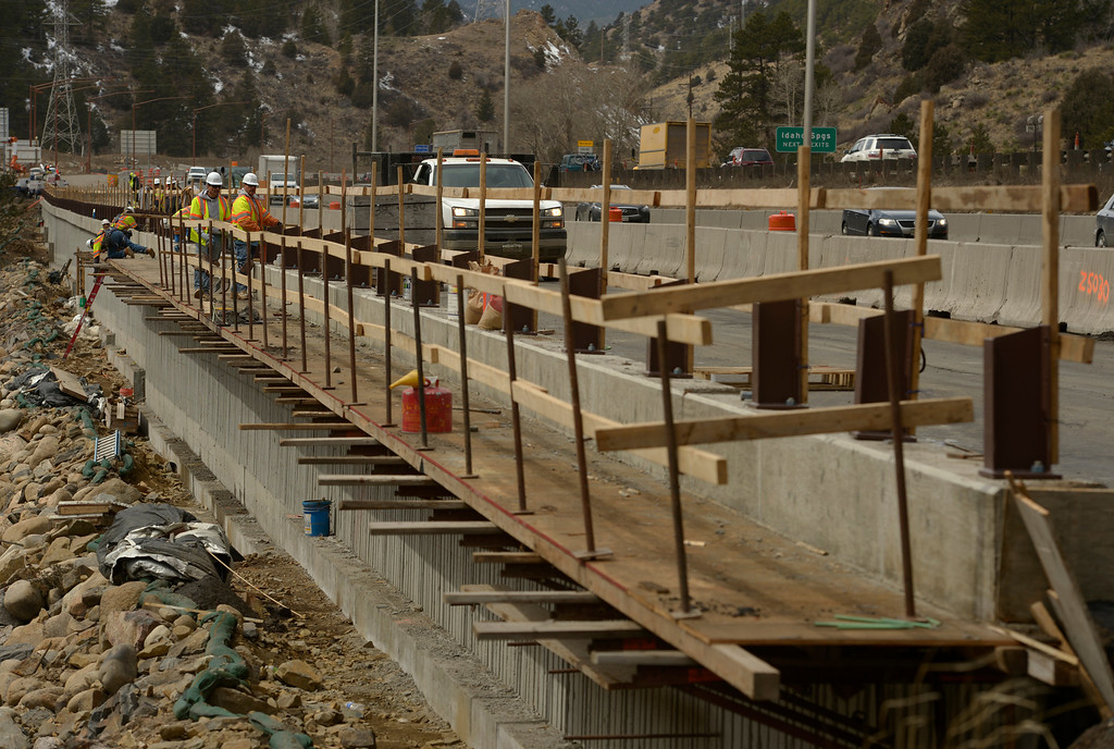. IDAHO SPRINGS, CO- MARCH 28:  Crews work on the walls of the new lanes of the highway just west of the twin tunnels.  Construction continues on road work on I-70 and the twin tunnels near Idaho Springs on March 28th, 2013.  The highway is being widened in the east bound lanes.  The widening will start just west of the twin tunnels after Idaho Springs and will continue until the exit for Highway 6 where I-70 becomes three lanes.  They expect the project to be finished by the end of 2013.  (Photo By Helen H. Richardson/ The Denver Post)