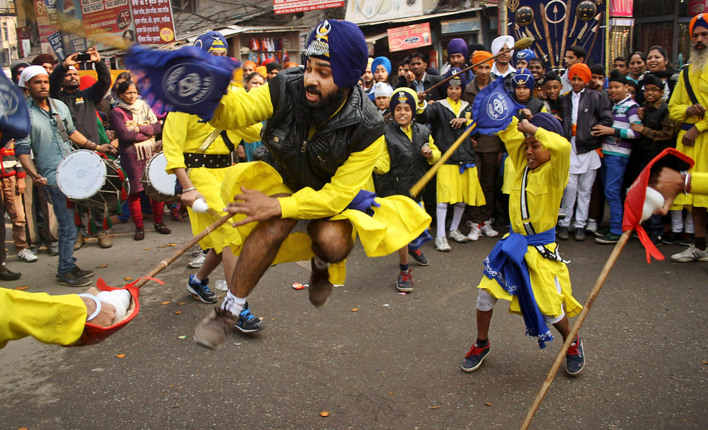 . Indian Sikhs perform the gatka, or Sikh martial arts, during a religious procession ahead of the birth anniversary of Guru Gobind Singh in Amritsar, India, Monday, Jan. 6, 2014. The birth anniversary of Guru Gobind Singh, the tenth Sikh guru, will be marked on Jan. 7 this year. (AP Photo/Sanjeev Syal)