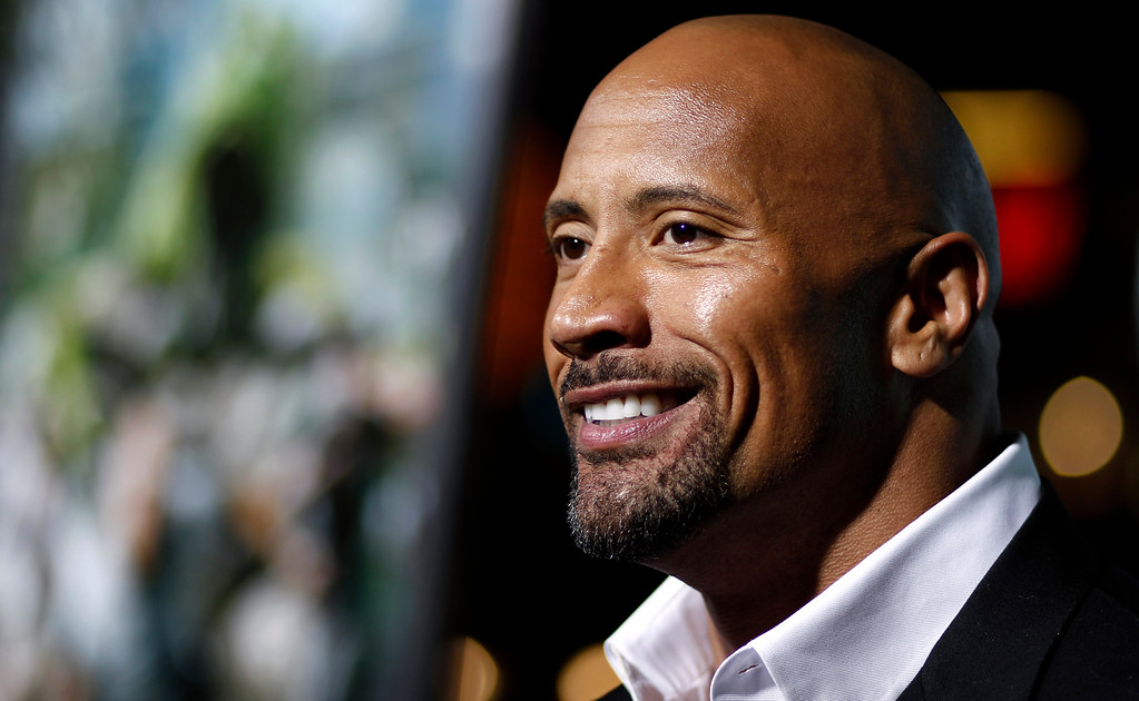 """. Cast member Dwayne \""""The Rock\"""" Johnson arrives at the premiere of \""""Journey 2: The Mysterious Island\"""" in Los Angeles, Thursday, Feb. 2, 2011.  \""""Journey 2: The Mysterious Island\"""" will be released Feb. 10, 2011.  (AP Photo/Matt Sayles)"""