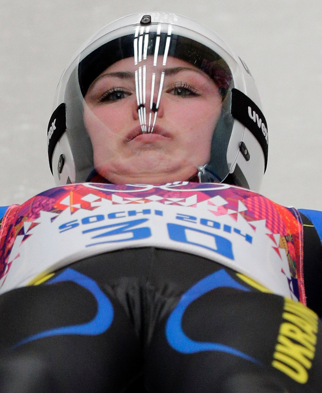 . Olena Stetskiv of Ukraine starts her second run during the women\'s singles luge competition at the 2014 Winter Olympics, Monday, Feb. 10, 2014, in Krasnaya Polyana, Russia. (AP Photo/Jae C. Hong)