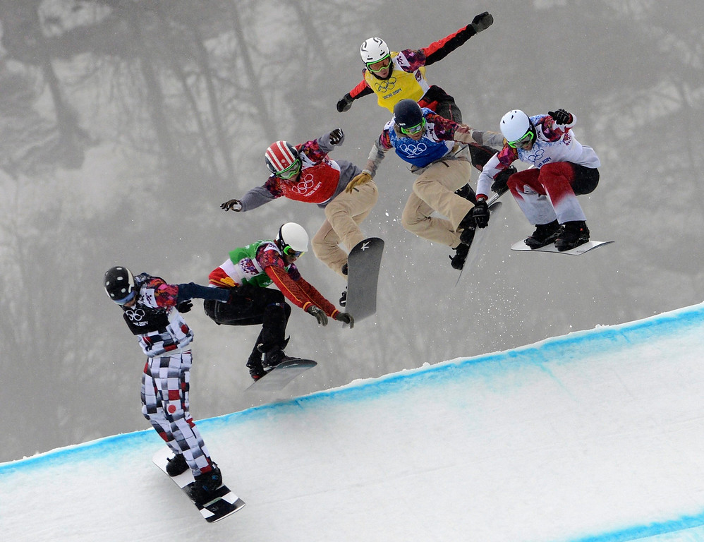 . (from left) Nikolay Olyunin of Russia, Lucas Eguibar of Spain, Trevor Jacob of USA, Alex Deibold of USA, Stian Siveryzen of Norway and Kevin Hill of Canada compete in the first semi final run in the Menës Snowboard Cross at Rosa Khutor Extreme Park at the Sochi 2014 Olympic Games, Krasnaya Polyana, Russia, 18 February 2014.  EPA/VASSIL DONEV