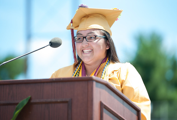 06/19/18 Wesley Bunnell | Staff New Britain High School Valedictorian Gabriella Roy smiles as she delivers her address during graduation exercises at Veterans' Memorial Stadium at Willow Brook Park on Tuesday morning.