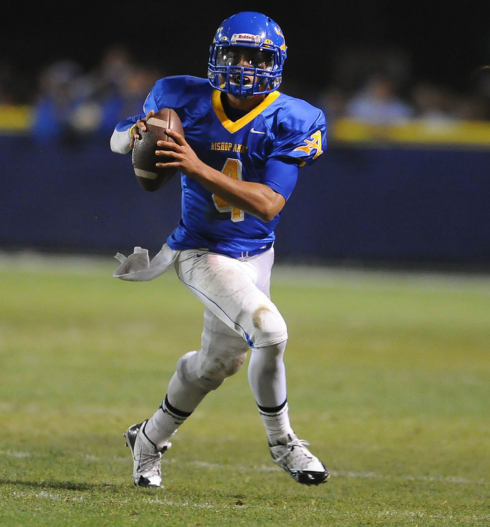 . Bishop Amat quarterback Koa Haynes (C) (4) scrambles in the first half of a prep football game against Alemany at Bishop Amat High School in La Puente, Calif., on Friday, Oct. 25, 2013.    (Keith Birmingham Pasadena Star-News)