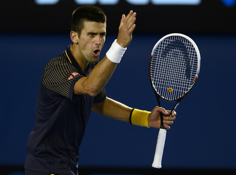 . Serbia\'s Novak Djokovic reacts after a point against Britain\'s Andy Murray during the men\'s singles final on day 14 of the Australian Open tennis tournament in Melbourne on January 27, 2013.  MANAN VATSYAYANA/AFP/Getty Images