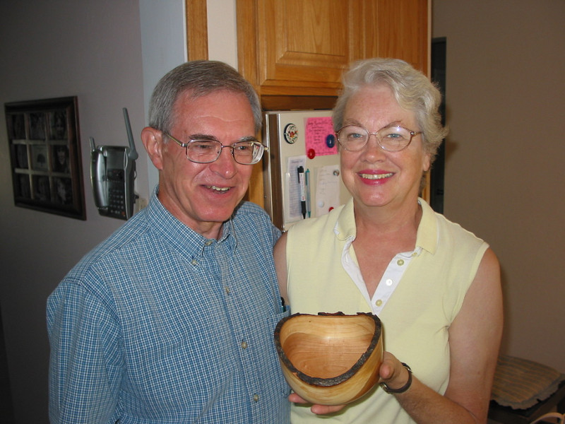 Don Voas and Beth Garcia holding one of the bowls Don has turned