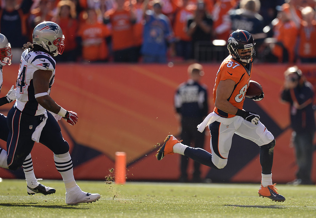 . Denver Broncos wide receiver Eric Decker (87) makes a catch in the first quarter. The Denver Broncos take on the New England Patriots in the AFC Championship game at Sports Authority Field at Mile High in Denver on January 19, 2014. (Photo by Hyoung Chang/The Denver Post)